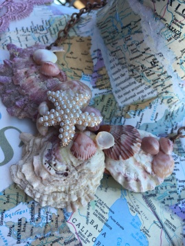 Seashell Necklace On Map Covered Maniquin
